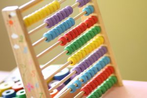 An image of an abacus in a classroom that features primary colours that have beeb painted by A&J Painters & Decorators.