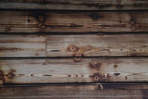 An image of a wooden fence, prior to staining.